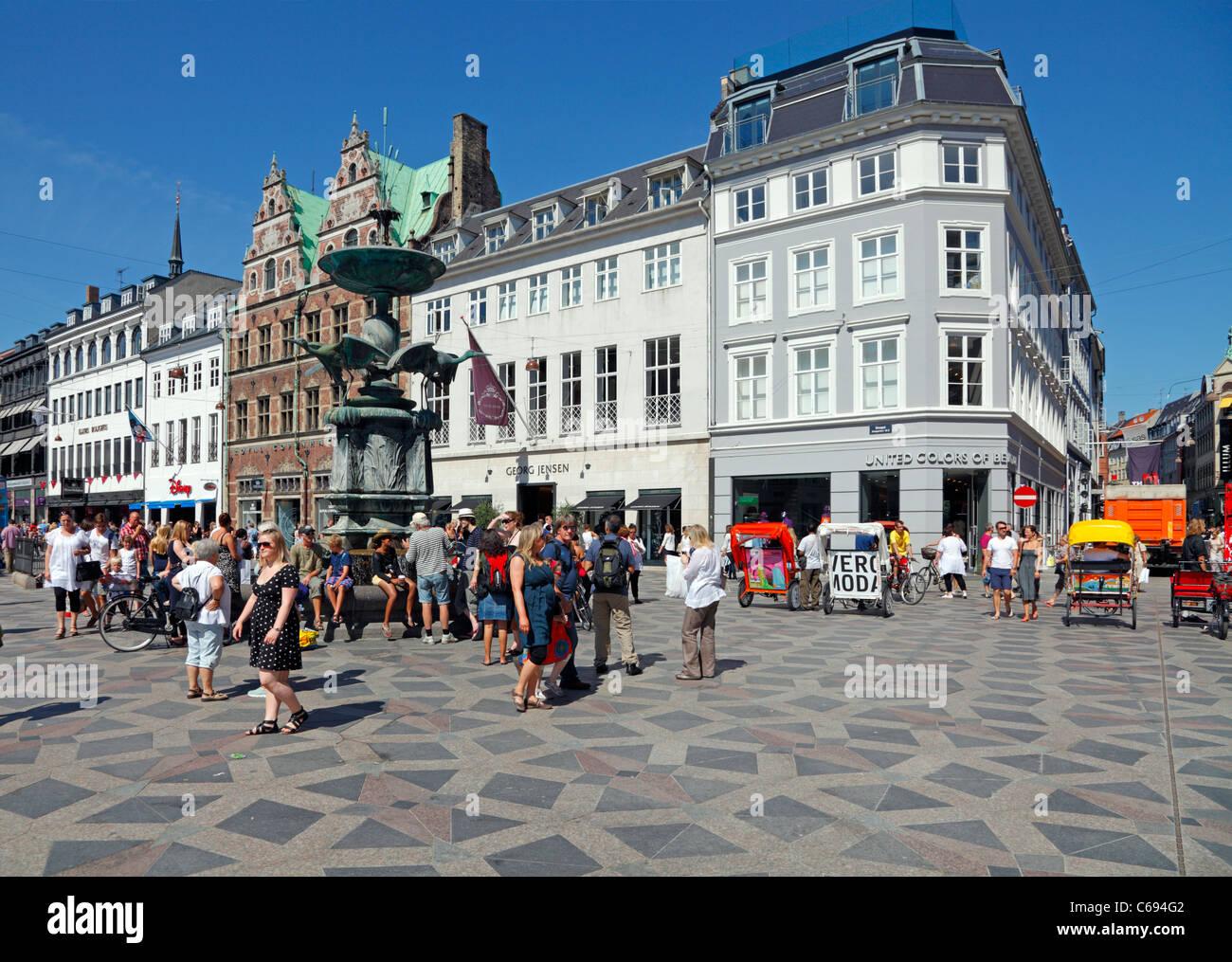 The Stork Fountain on the pedestrian street Strøget in Copenhagen. The shops of Georg Jensen and Royal Copenhagen - Stock Image