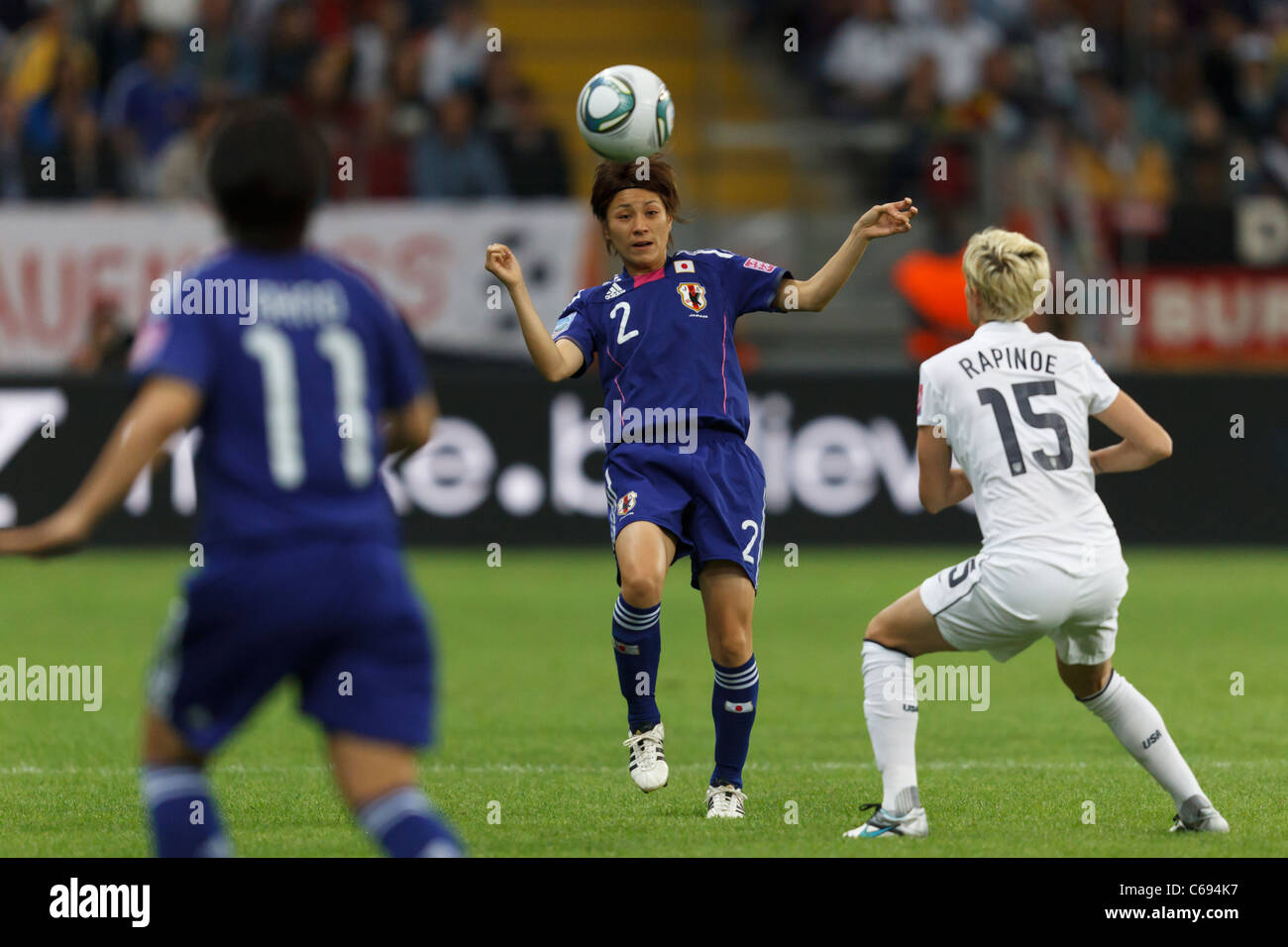 Yukari Kinga of Japan (2) heads the ball during the FIFA Women's World Cup final against the USA July 17, 2011. - Stock Image