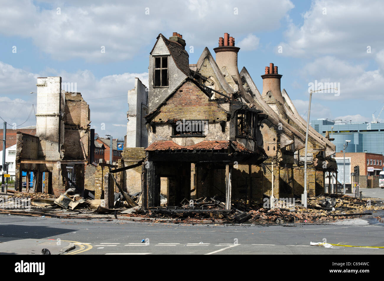 Burnt out Reeves Furnishing store Croydon Riots London Uk - Stock Image