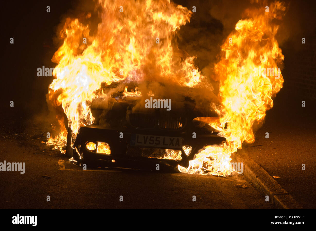 Burning BMW car Farquarson Road Croydon 9th August  2011 riots. - Stock Image