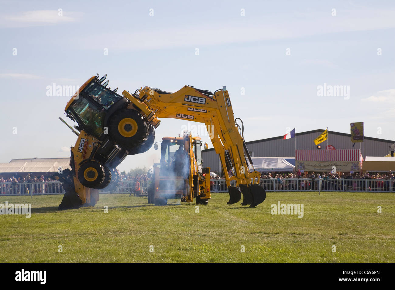 North Wales Demonstration showing the versatility of JCB diggers in showground of agricultural show small vehicle - Stock Image