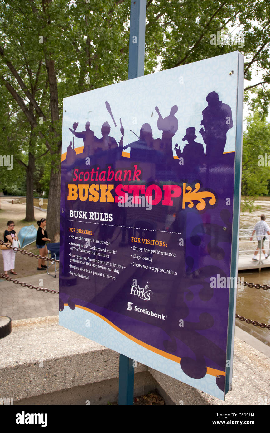 busk stop information outlining busking rules at the forks Winnipeg Manitoba Canada - Stock Image