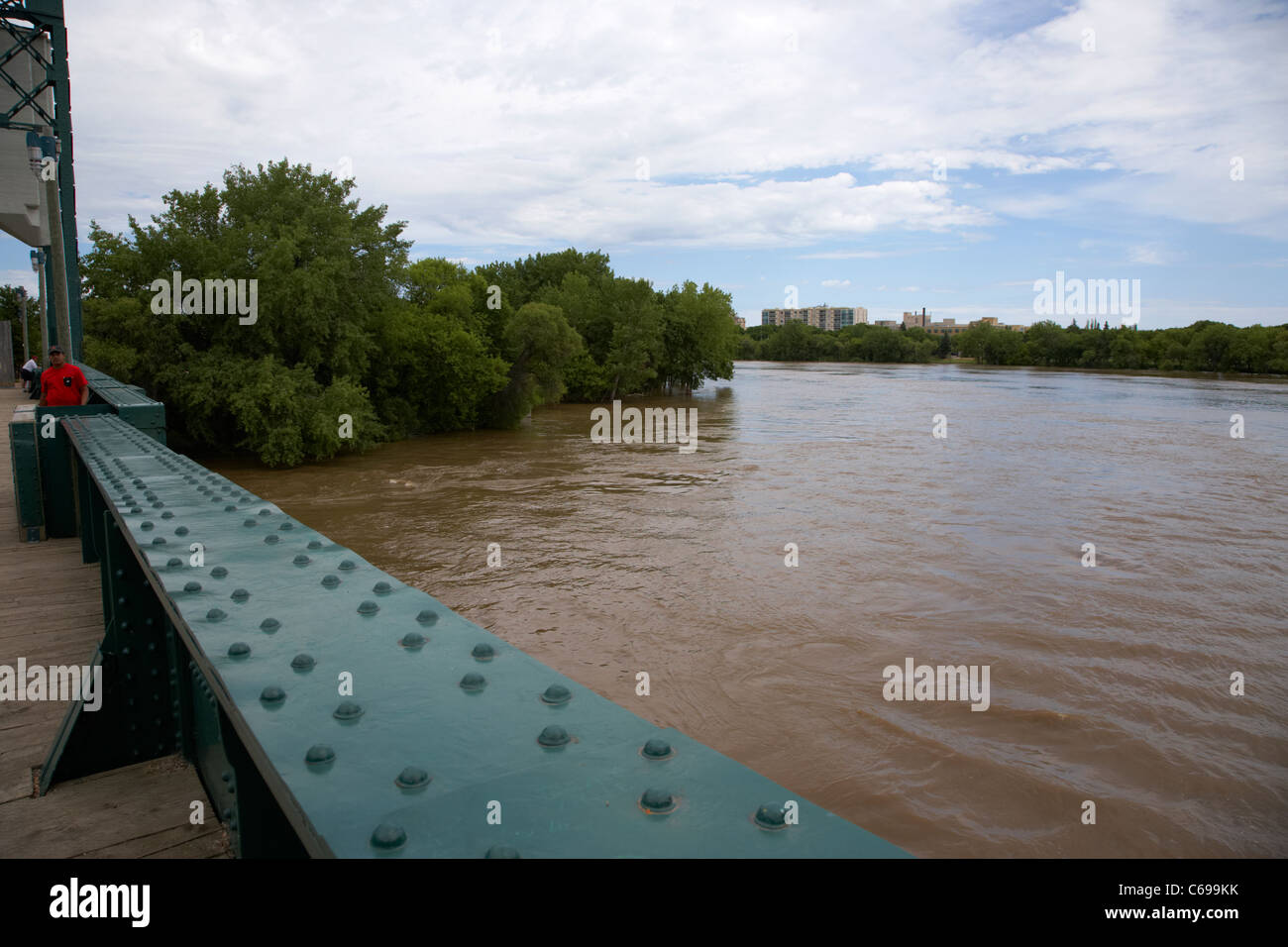 the forks junction of the red and assiniboine rivers viewed from the historic rail bridge Winnipeg Manitoba Canada - Stock Image