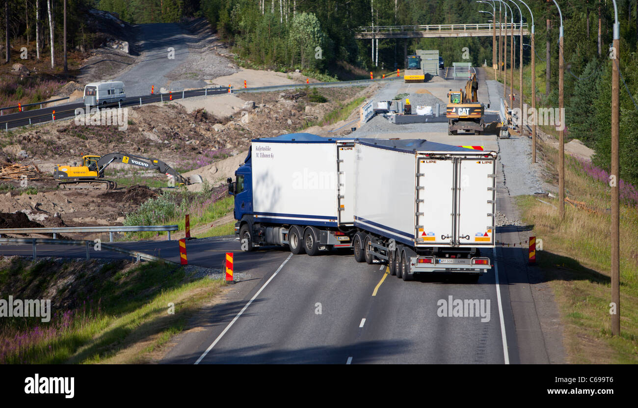 Roadworks on a highway divert traffic to a temporary road , Finland - Stock Image