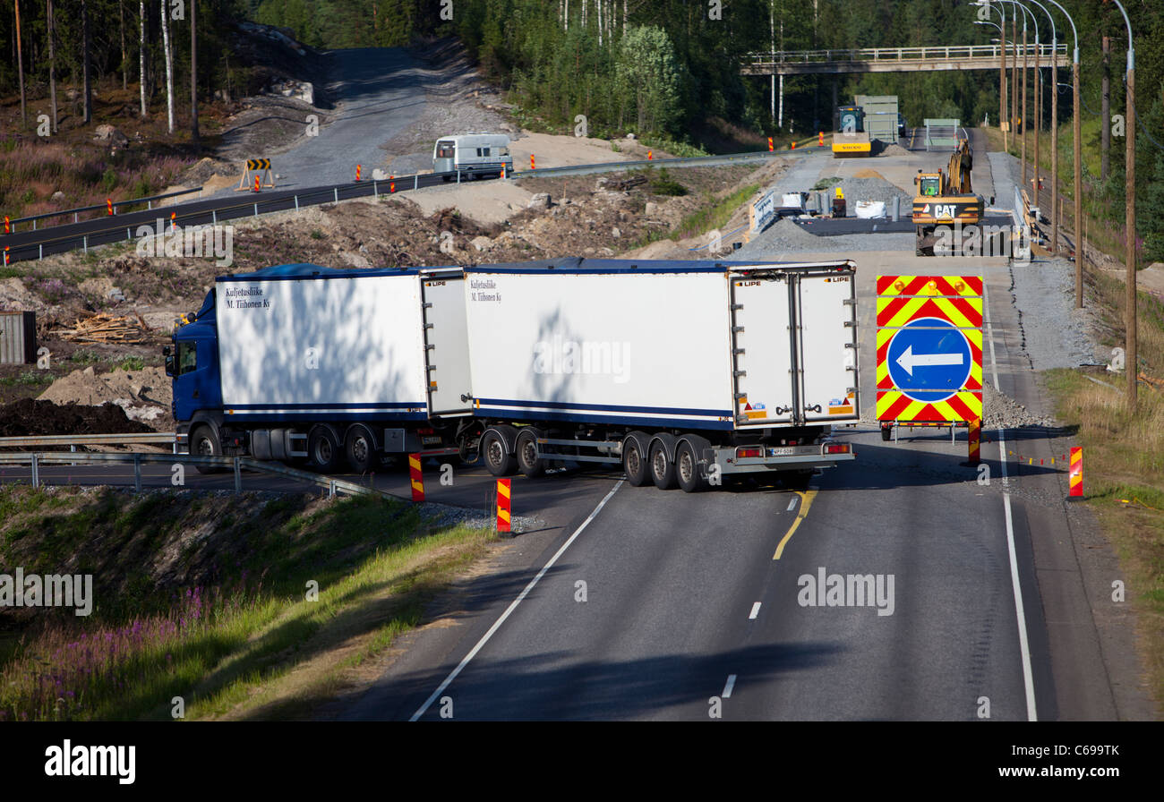 Roadworks on a highway traffic rerouted to temporary road , Finland - Stock Image