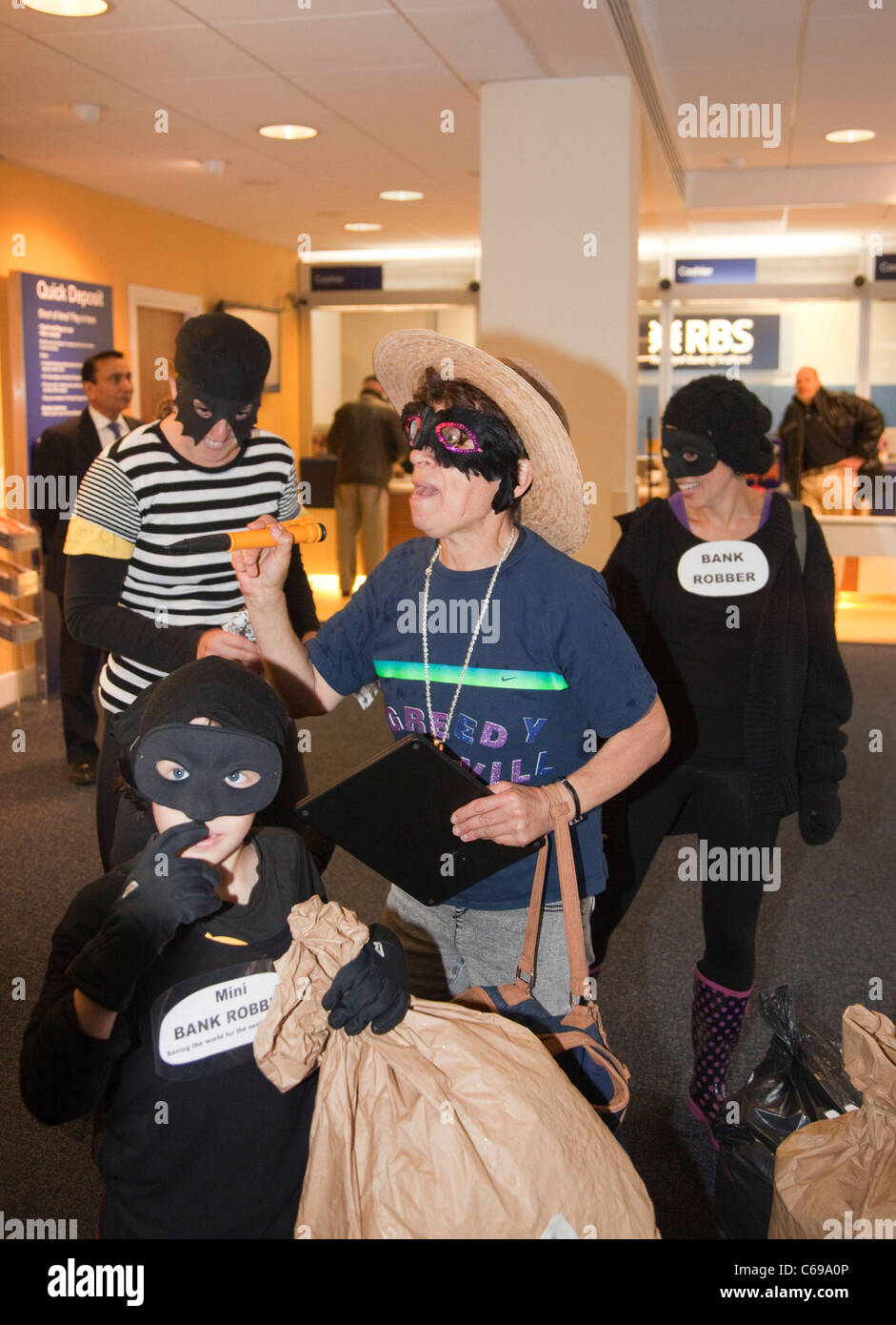 Activists from UK Uncut and Fight Racism, Fight Imperialism inside the Royal Bank of Scotland branch at the Angel - Stock Image