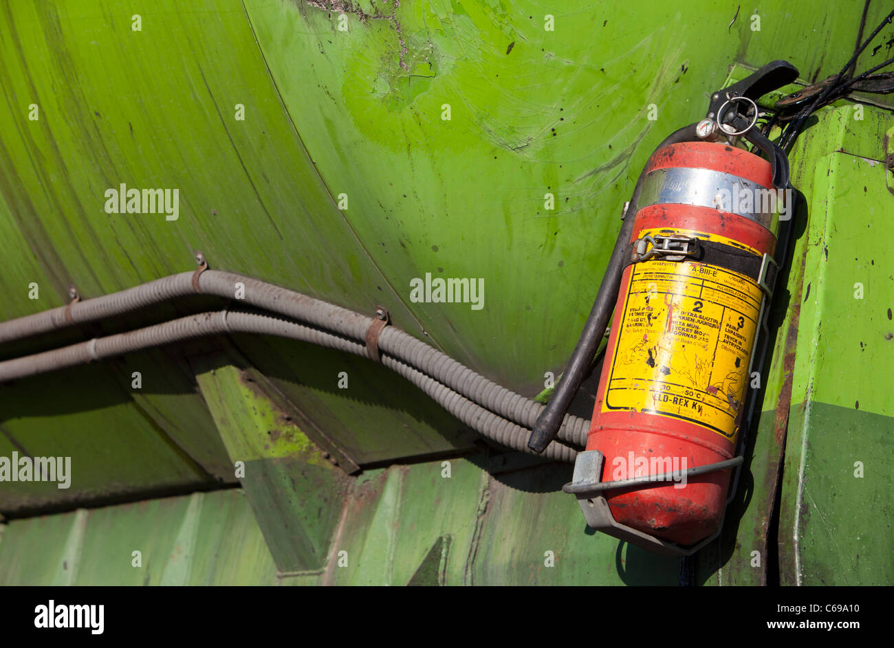 Old scuffed fire extinguisher - Stock Image