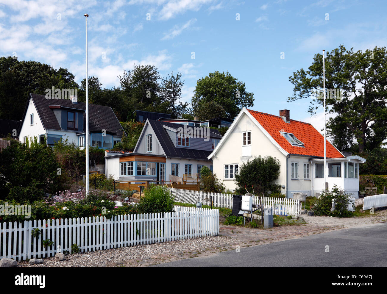 Group of the very attractive houses north of Humlebæk Harbour at the old coastal road to Elsinore very close - Stock Image