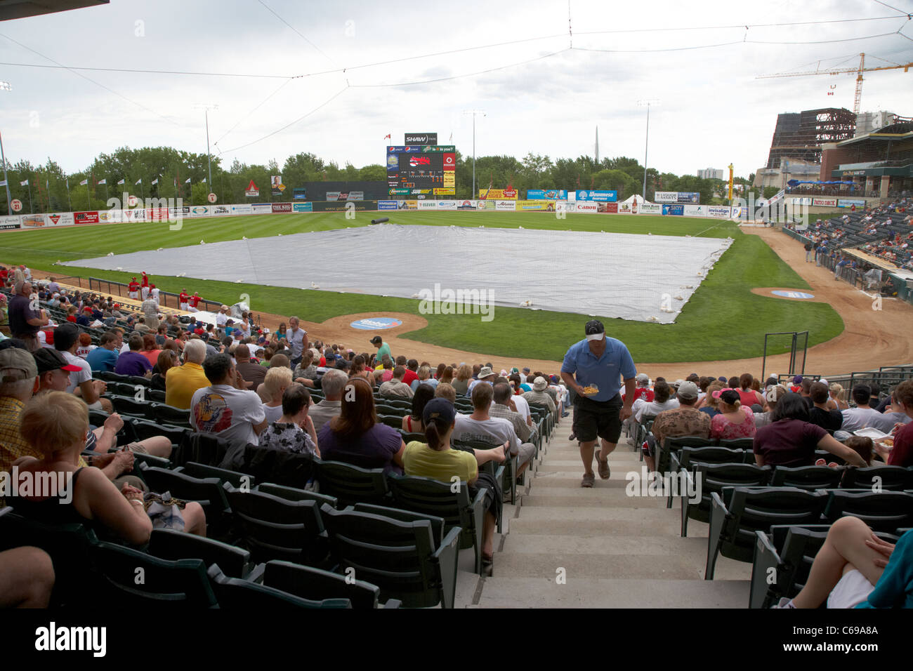 diamond covered due to rain at shaw park baseball stadium formerly canwest home to the winnipeg goldeyes Winnipeg - Stock Image