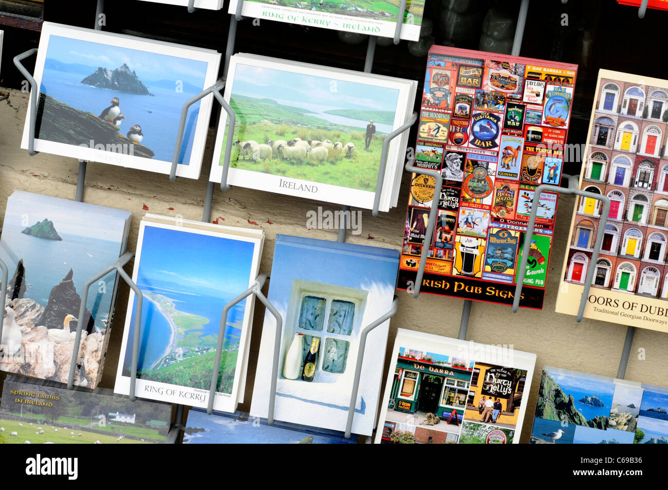 Postcards for sale outside a shop in Sneem, County Kerry, Ireland - Stock Image