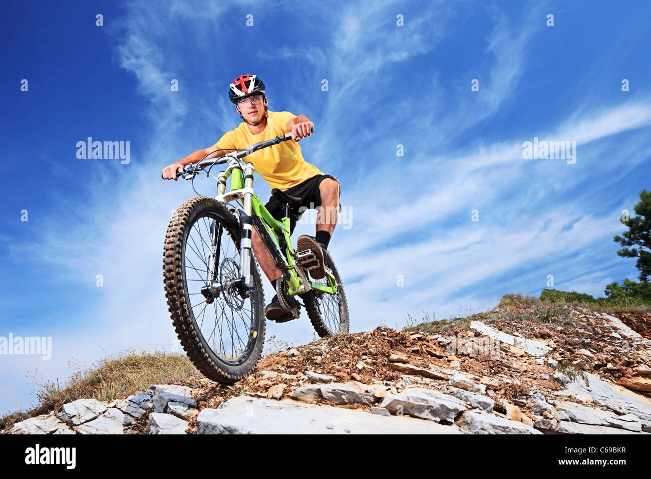 A young male riding a mountain bike - Stock Image