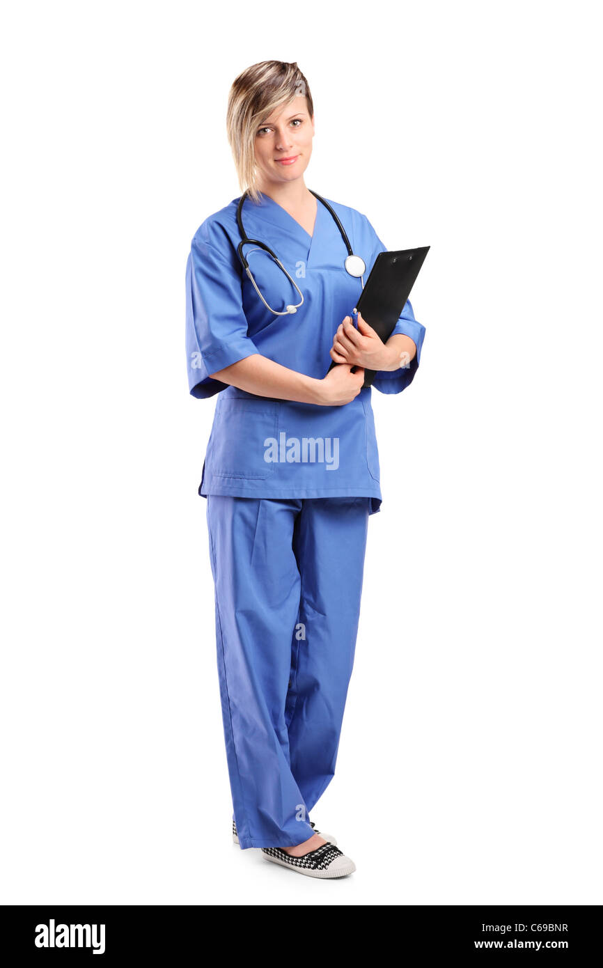 Full length portrait of a smiling healthcare professional holding a clipboard - Stock Image