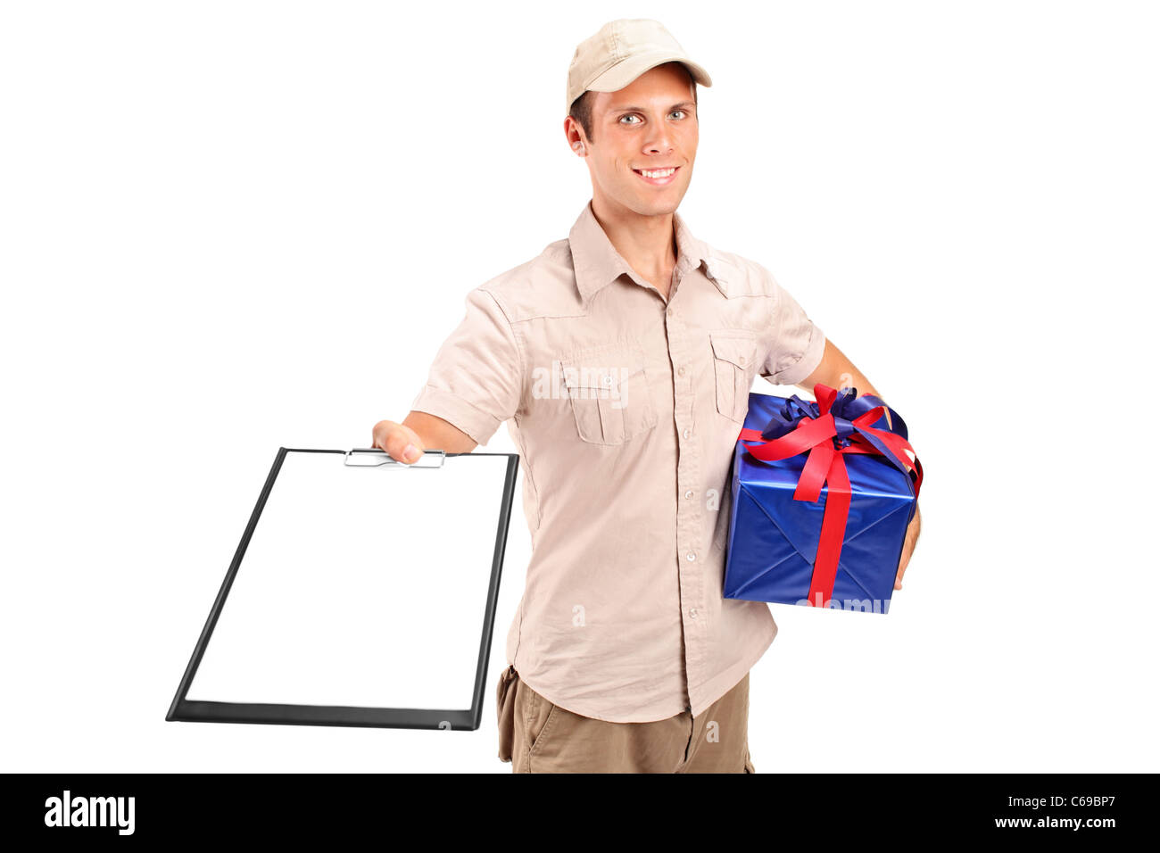 Delivery person delivering a gift and holding a clipboard - Stock Image