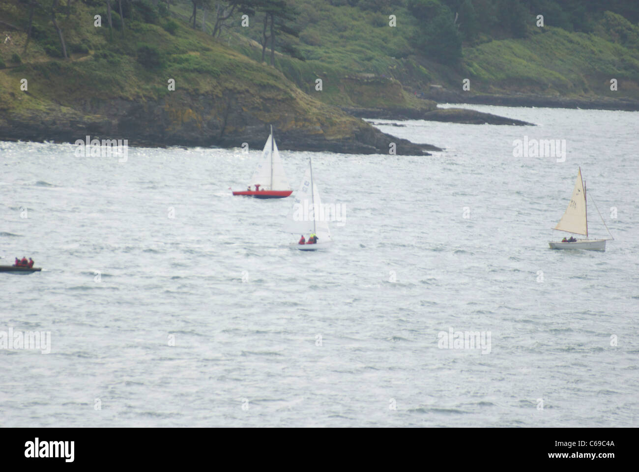 Sailing ships in the water off St Mawes Castle South Cornwall UK - Stock Image