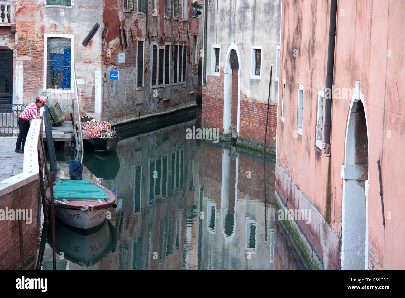 Gondolier overlooking Rio de S. Anzolo, Venice, Italy - Stock Image