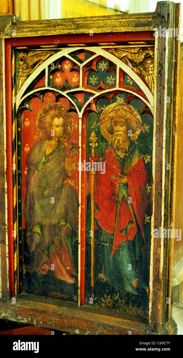 Castle Acre, Norfolk. Rood screen, St. John the Divine, St. James the Great, 15th century. John holds the poisoned - Stock Image