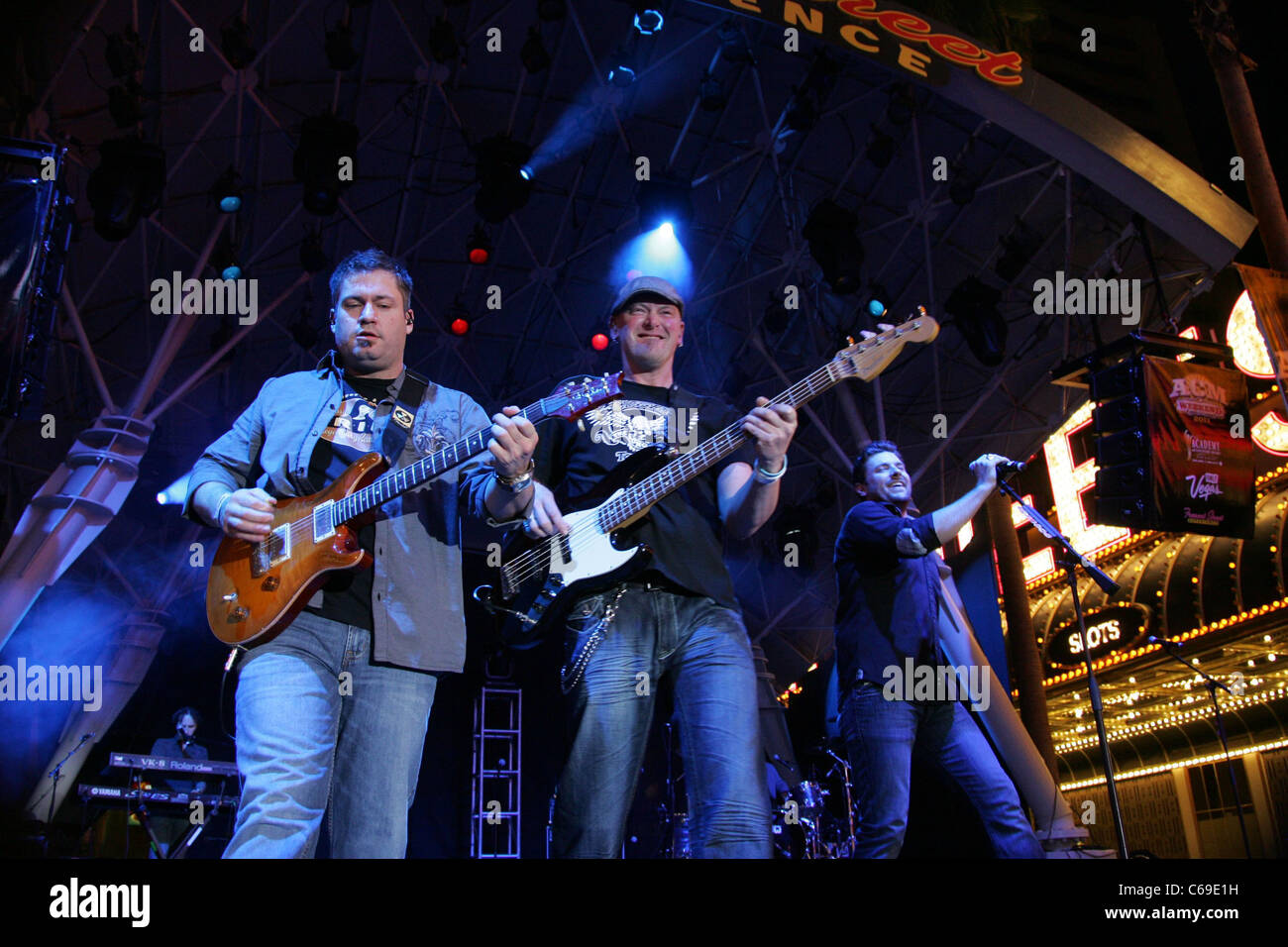 Band members, Chris Young (right) on stage for ACM Concerts at Fremont Street Experience - FRI, , Las Vegas, NV - Stock Image