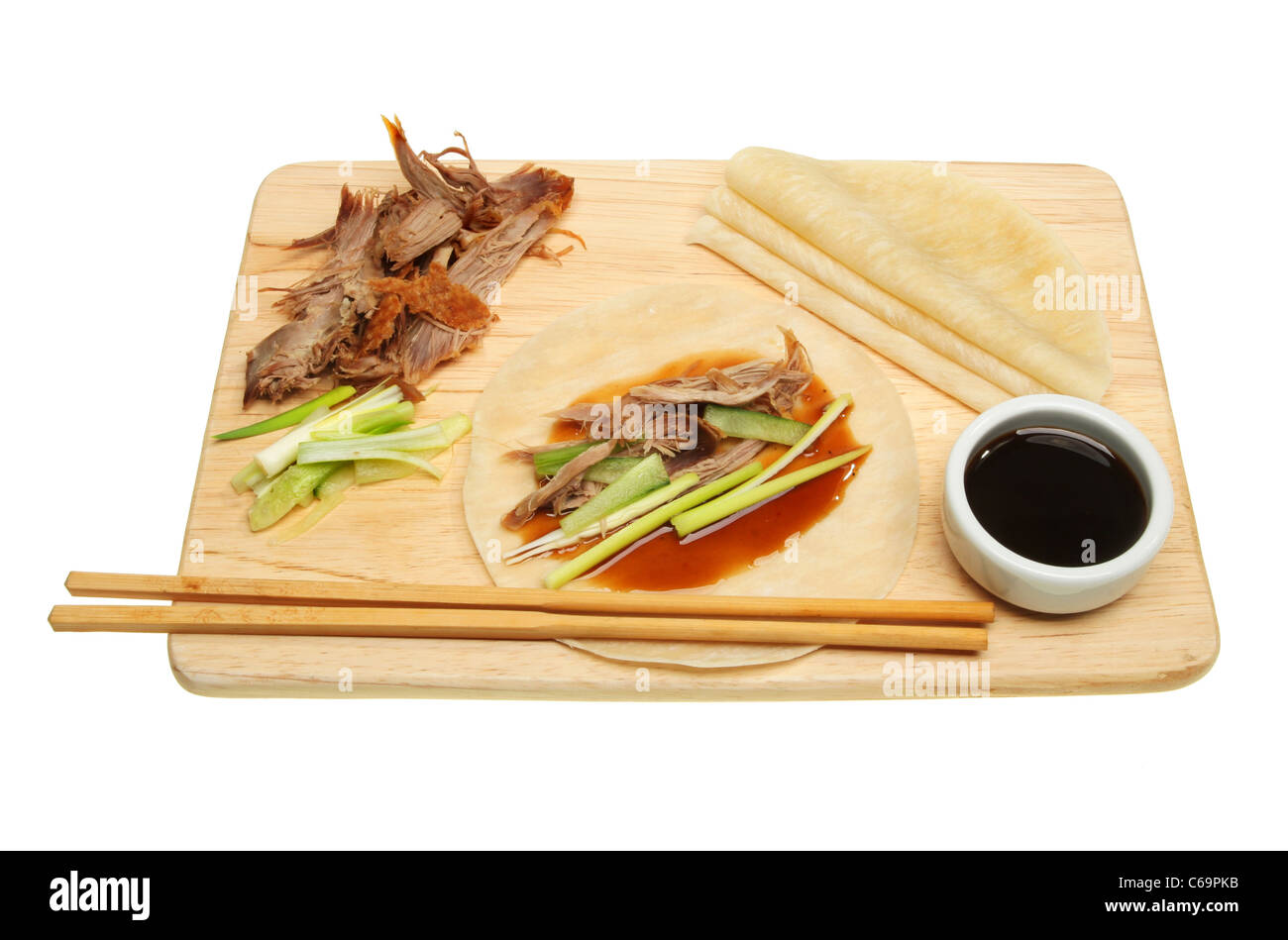 Chinese style crispy duck and pancakes on a board - Stock Image