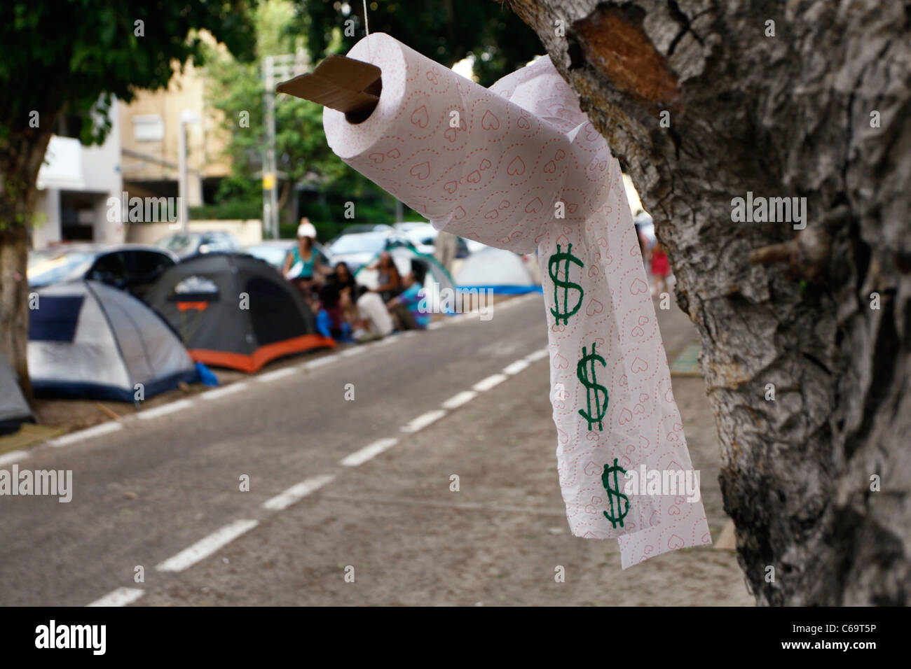 a toilet paper with american dollar symbol hanged at the tent city