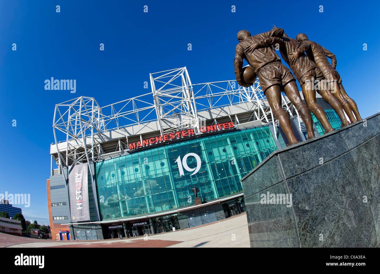 Main entrance of Manchester United FC's ground at Old Trafford in Manchester showing the 'Holy Trinity' - Stock Image