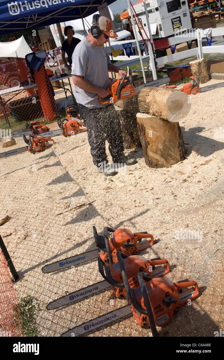 Husqvarna chainsaw demo at Woodsmen's Field Days, Boonville, Adirondacks, New York State - Stock Image