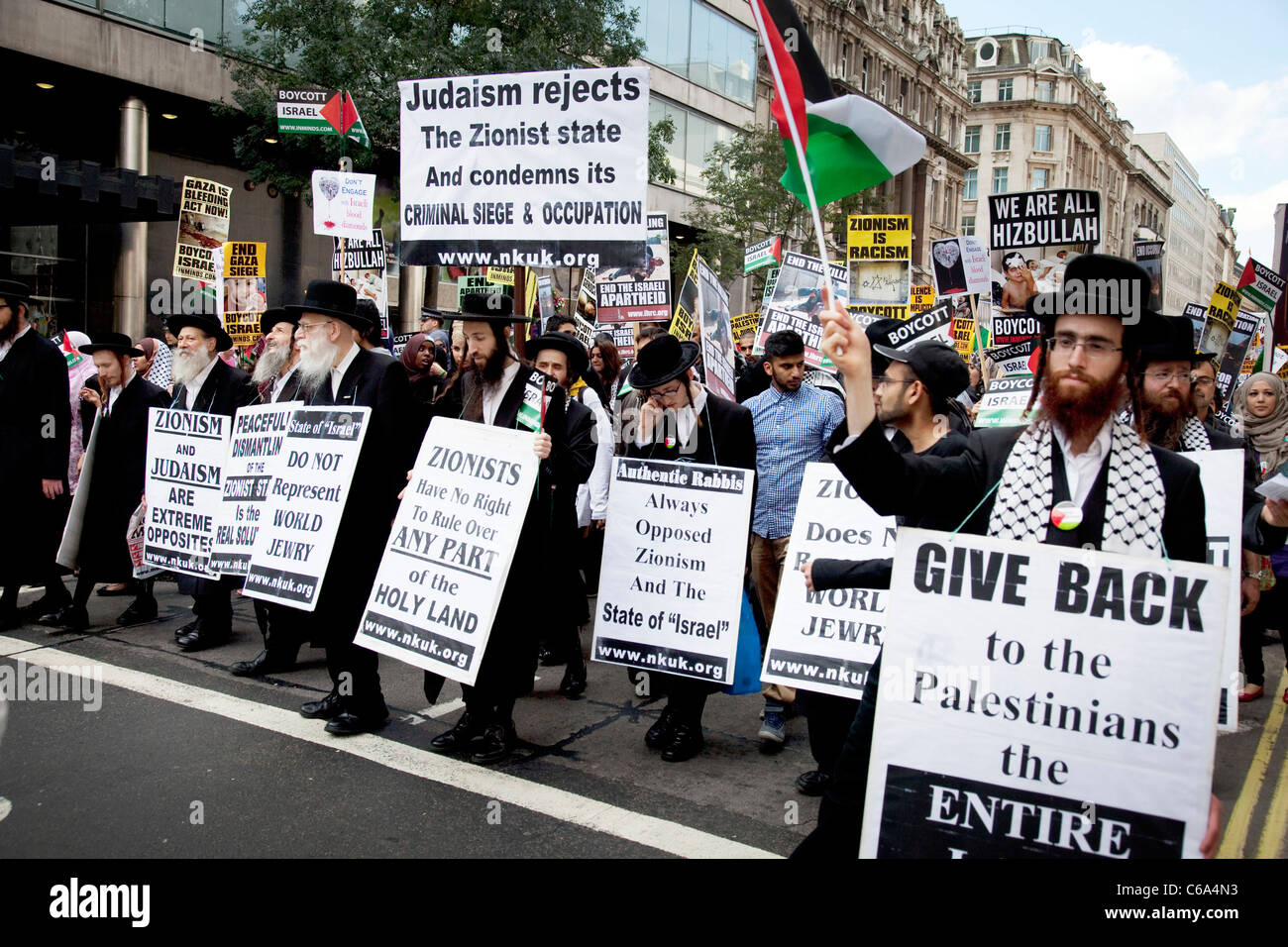 Orthodox Jewish anti Israeli / Zionism demonstration in London. Jews protesting against occupation and a closed - Stock Image