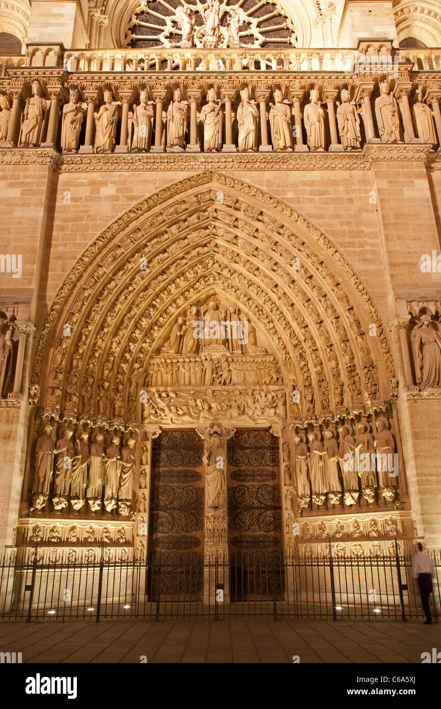 Paris - main portal of Notre-Dame cathedral at night Stock Photo