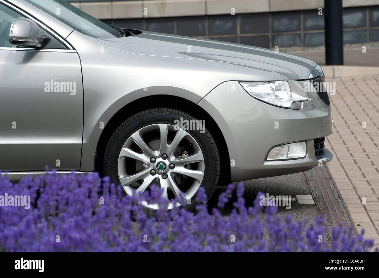 Close up of the front side of a Silver Skoda Superb car parked outside offices in England. - Stock Image