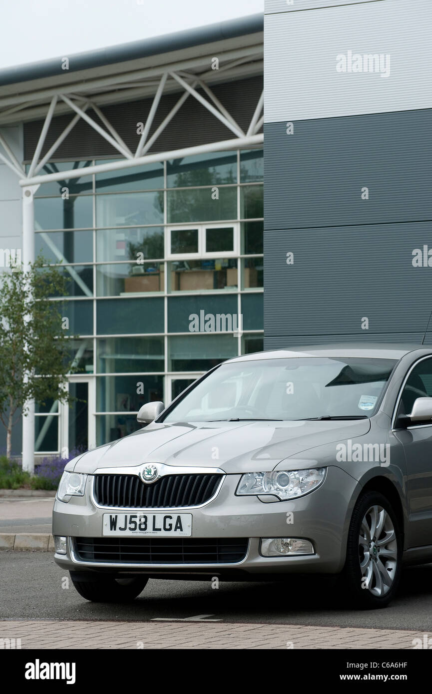 Silver Skoda Superb car parked outside offices in England. - Stock Image