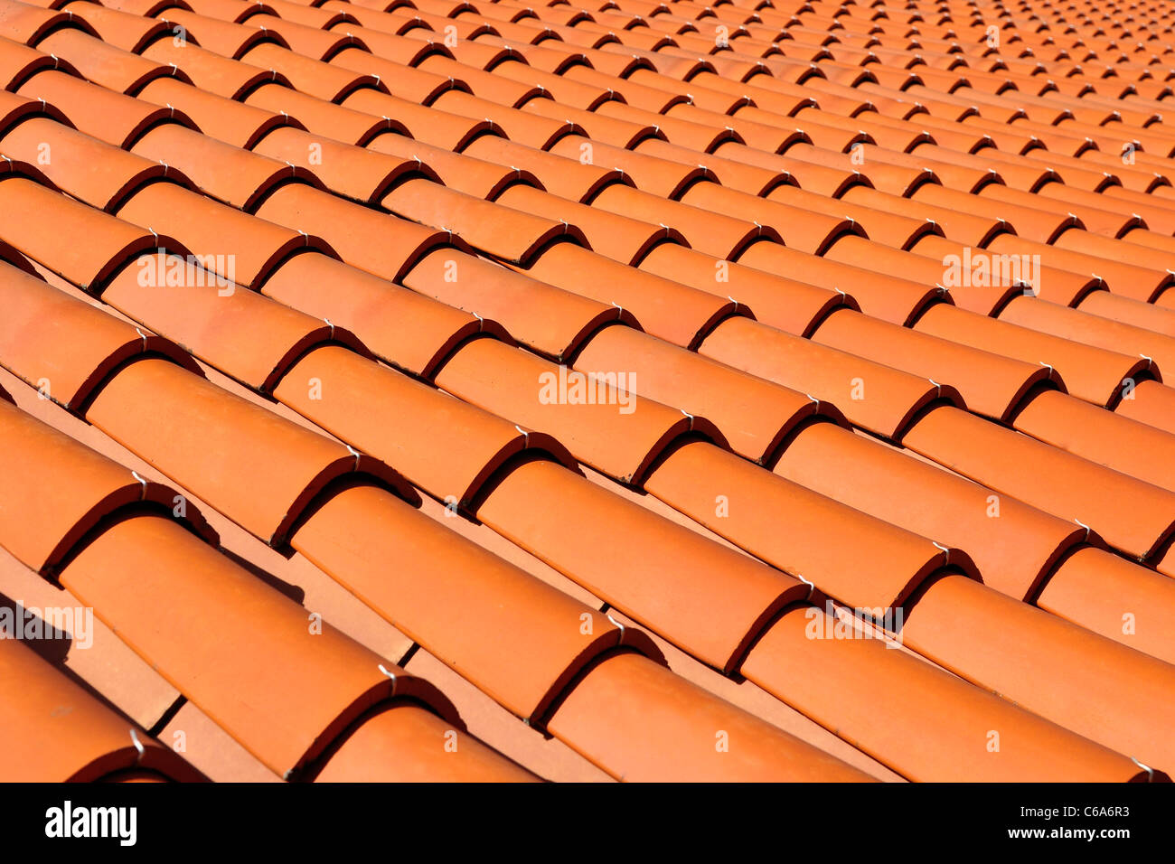 Orange roof tiles made from a ceramic material - Stock Image