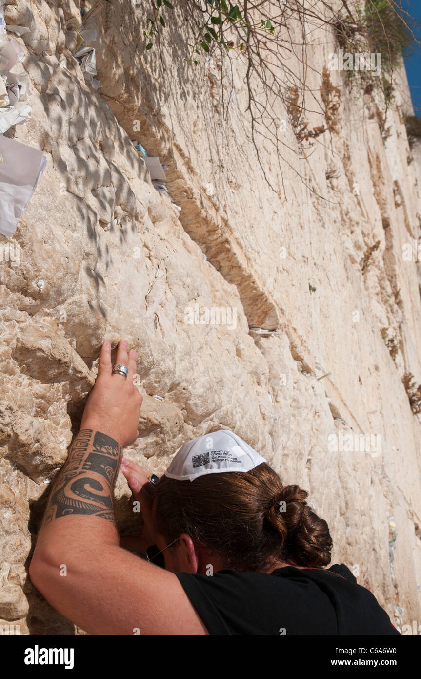 close up of a jew with tattoo praying at the western wall. Jerusalem Old City. israel - Stock Image