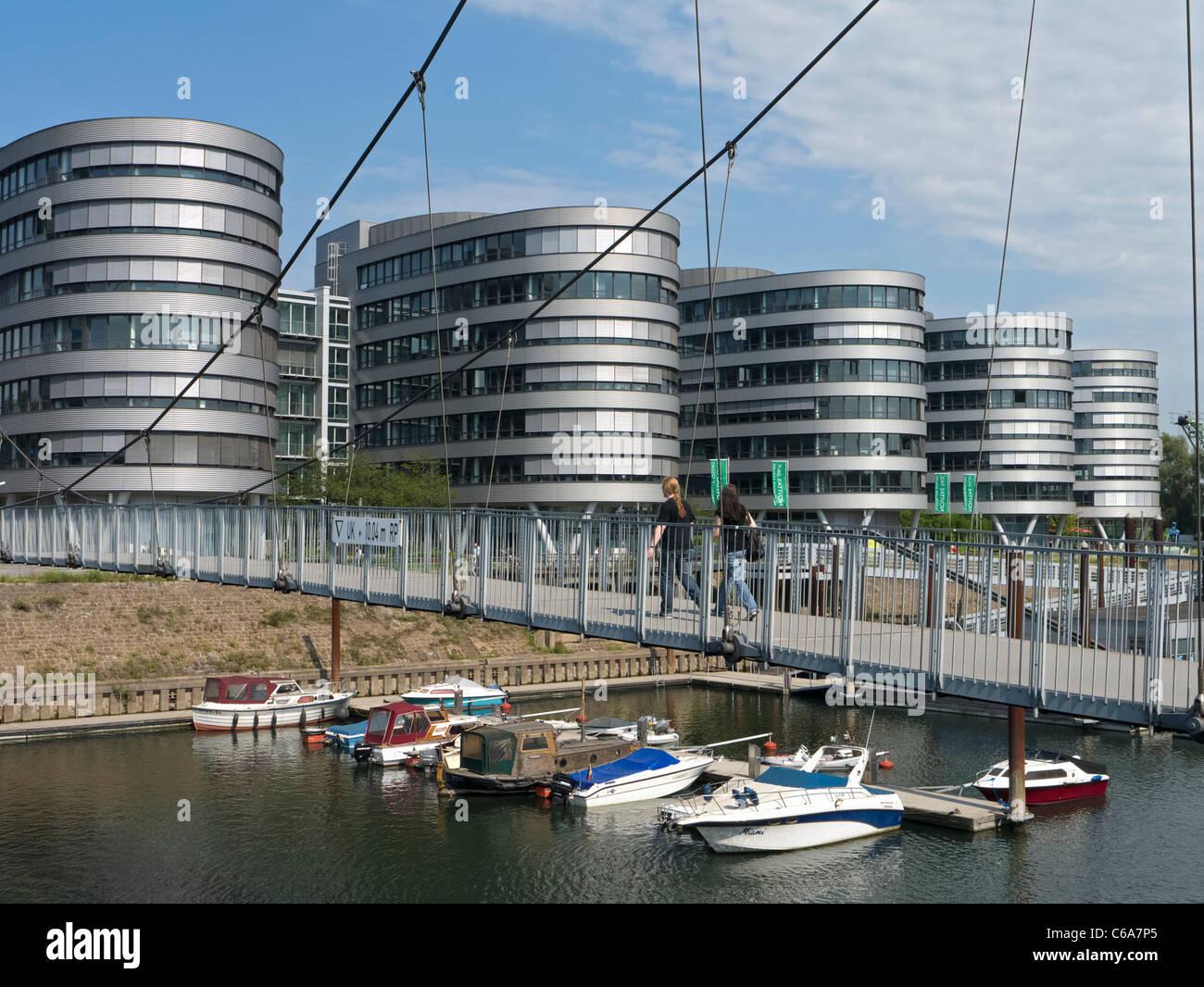 Modern footbridge and office buildings at Innenhafen area of Duisburg in North Rhine-Westphalia Germany - Stock Image