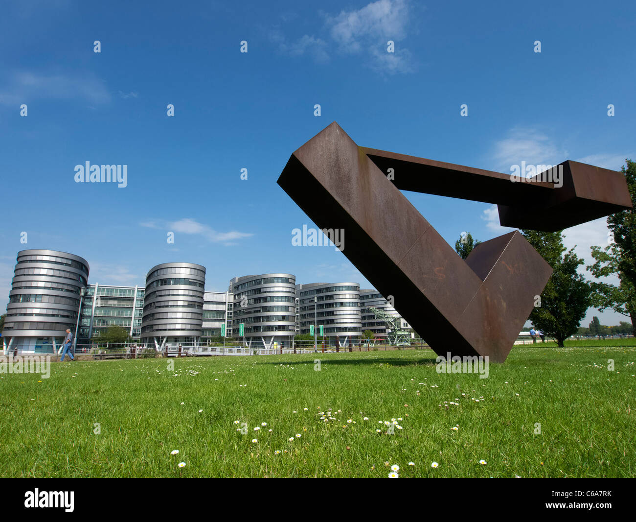 Steel sculpture and modern office buildings at Innenhafen area of Duisburg in North Rhine-Westphalia Germany - Stock Image