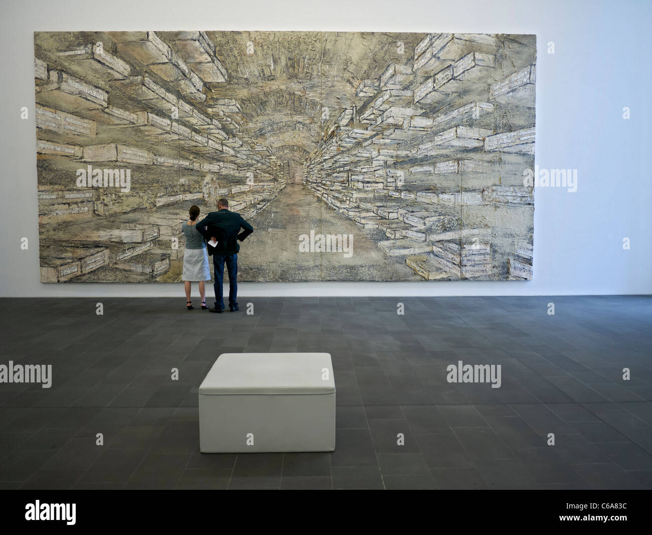 Looking at painting Sternenlager IV by Anselm Kiefer at Kuppersmuhle Museum at Innenhafen  Duisburg in North Rhine - Stock Image