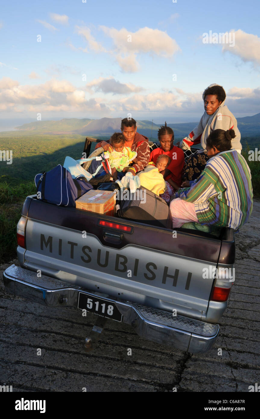Pacific islanders crowded on to the back of a pick-up truck. - Stock Image