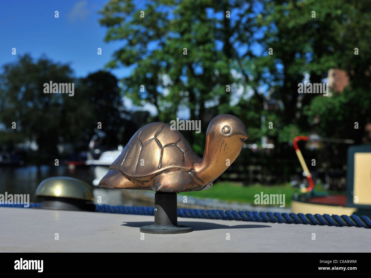 Small Brass Ornamental Turtle On Top Of Canal Longboat