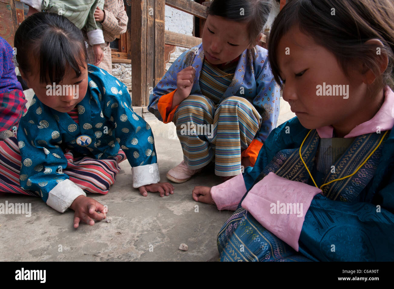 young schoolgirls playing together. Ura boarding school. Bhutan - Stock Image