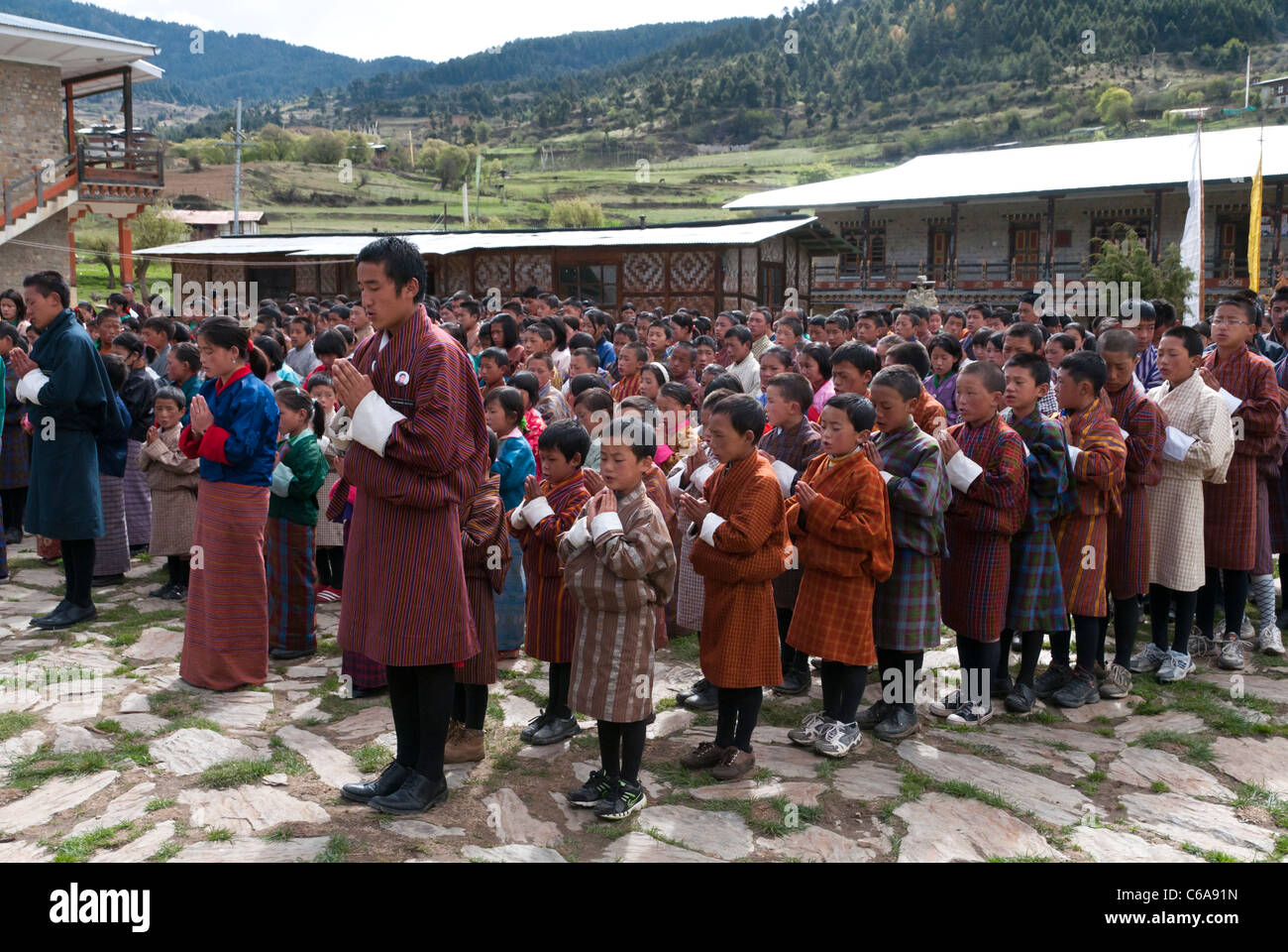 Morning prayer in Ura boarding school courtyard. Bhutan - Stock Image