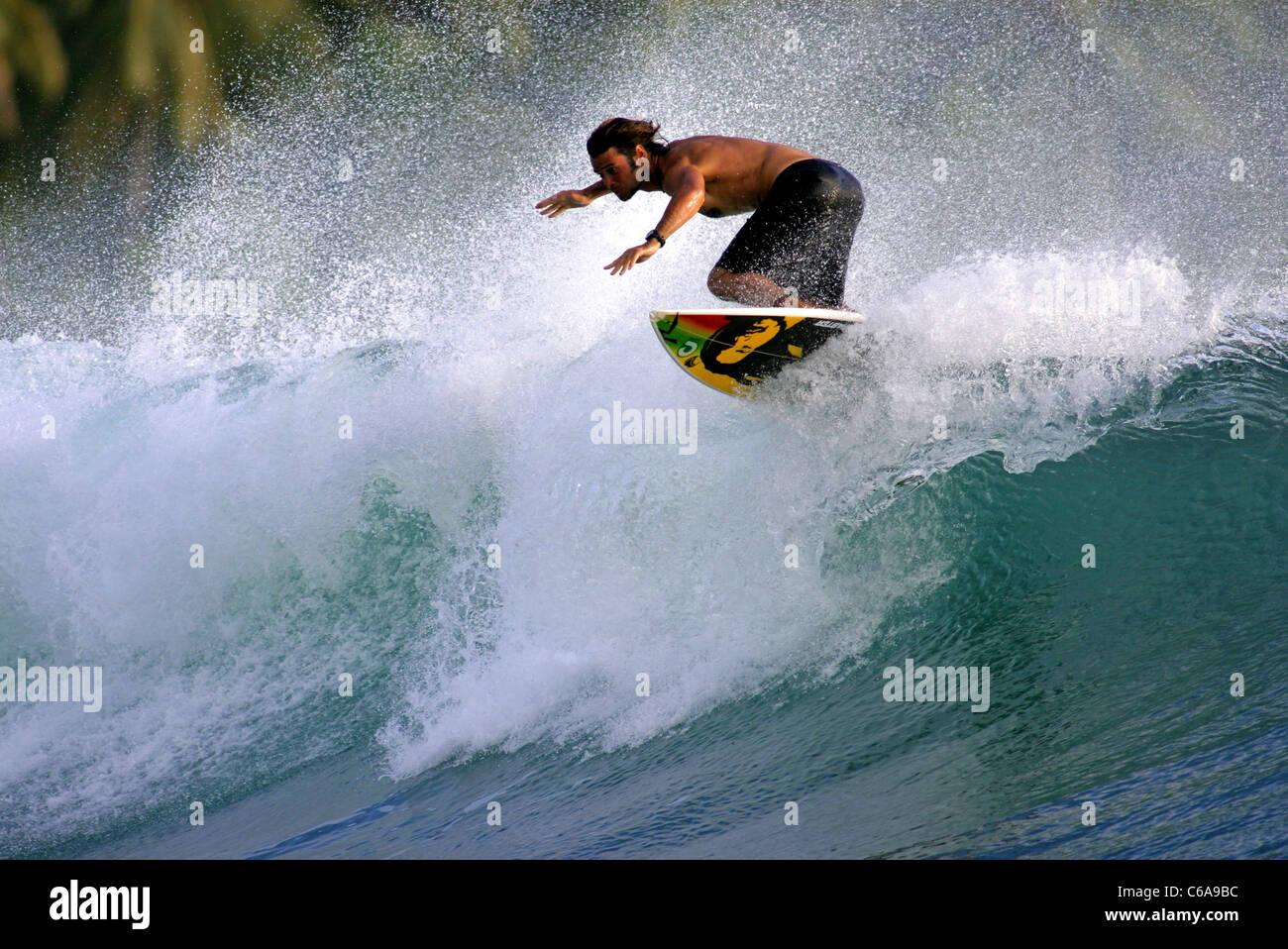 Surfing floater. Pulau Siberut, Mentawai Islands, West Sumatra, Sumatra, Indonesia, South-East Asia, Asia - Stock Image