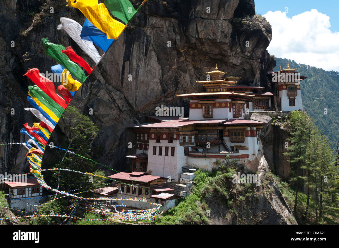 Taktshang Goemba. Tigers nest monastery. view with prayer flags and cliff. Paro valley, bhutan - Stock Image