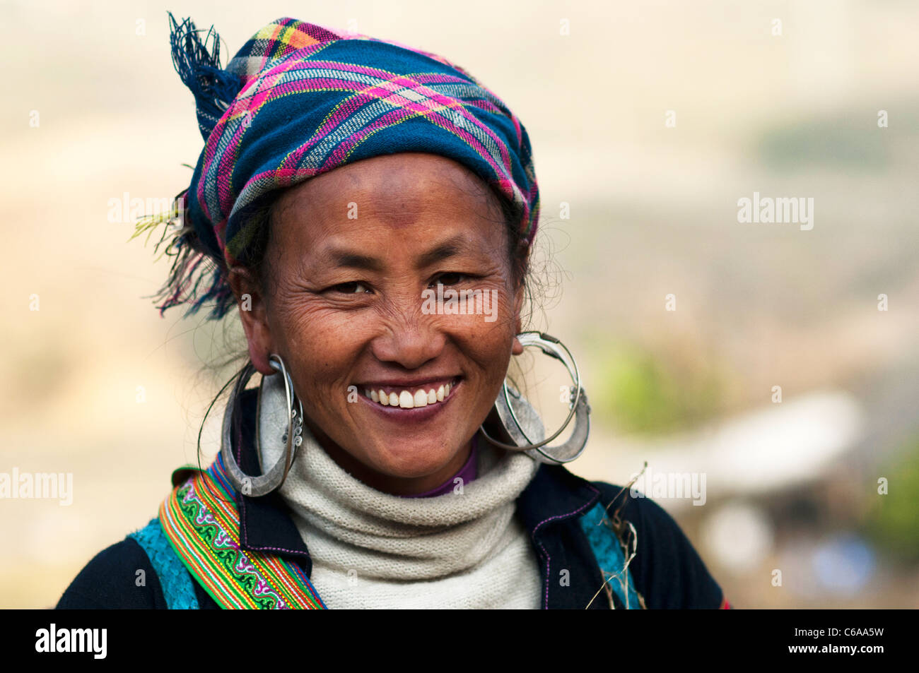 Portrait of a woman from the ethnic minority of the Hmongs in Sapa, North of Vietnam. - Stock Image