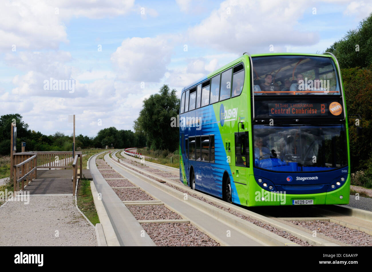 A Bus on The Cambridgeshire Guided Busway at Fen Drayton Lakes RSPB Nature Reserve, Cambridgeshire, England, UK - Stock Image