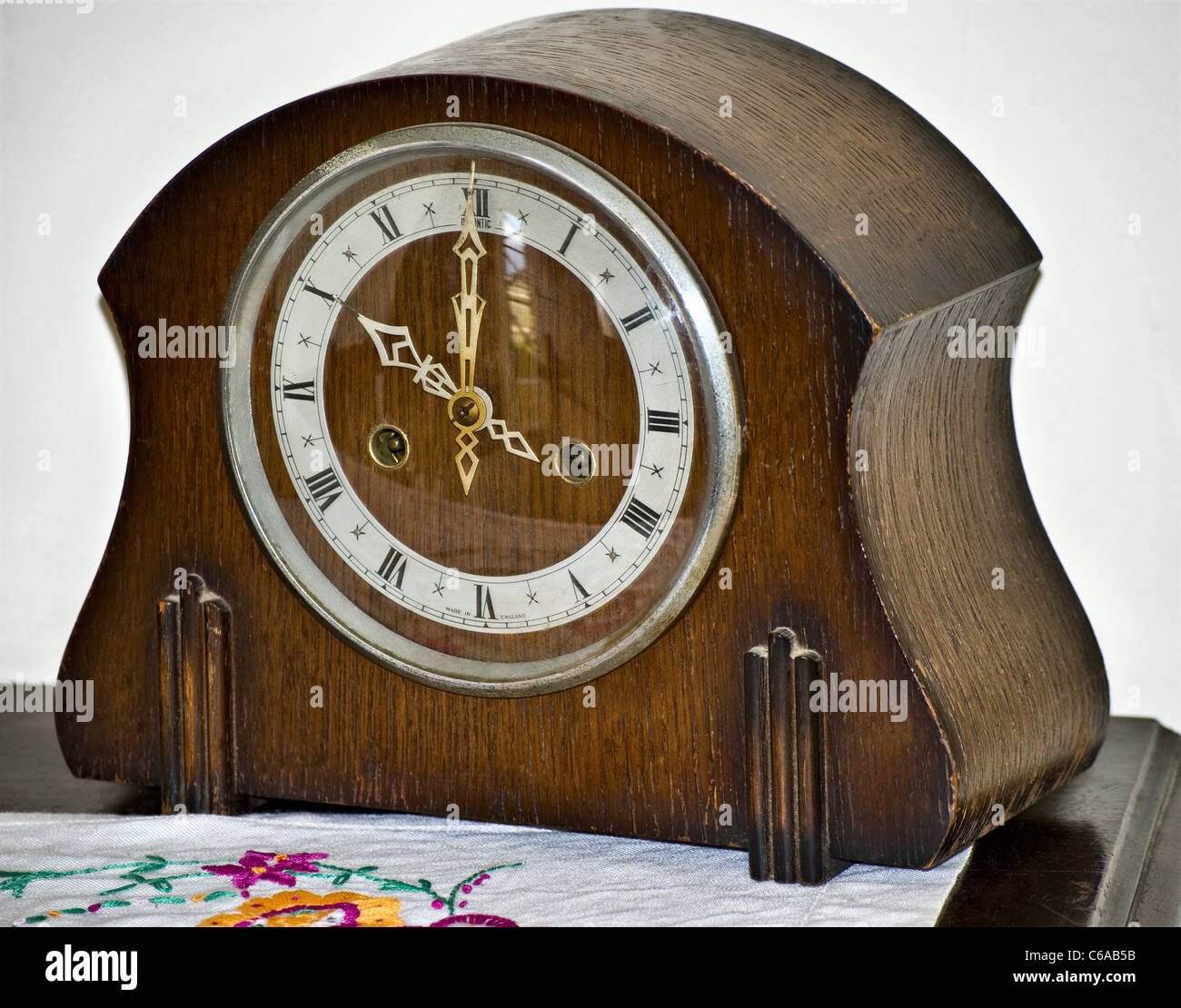 An early wooden mantelpiece clock (timepiece) - Stock Image