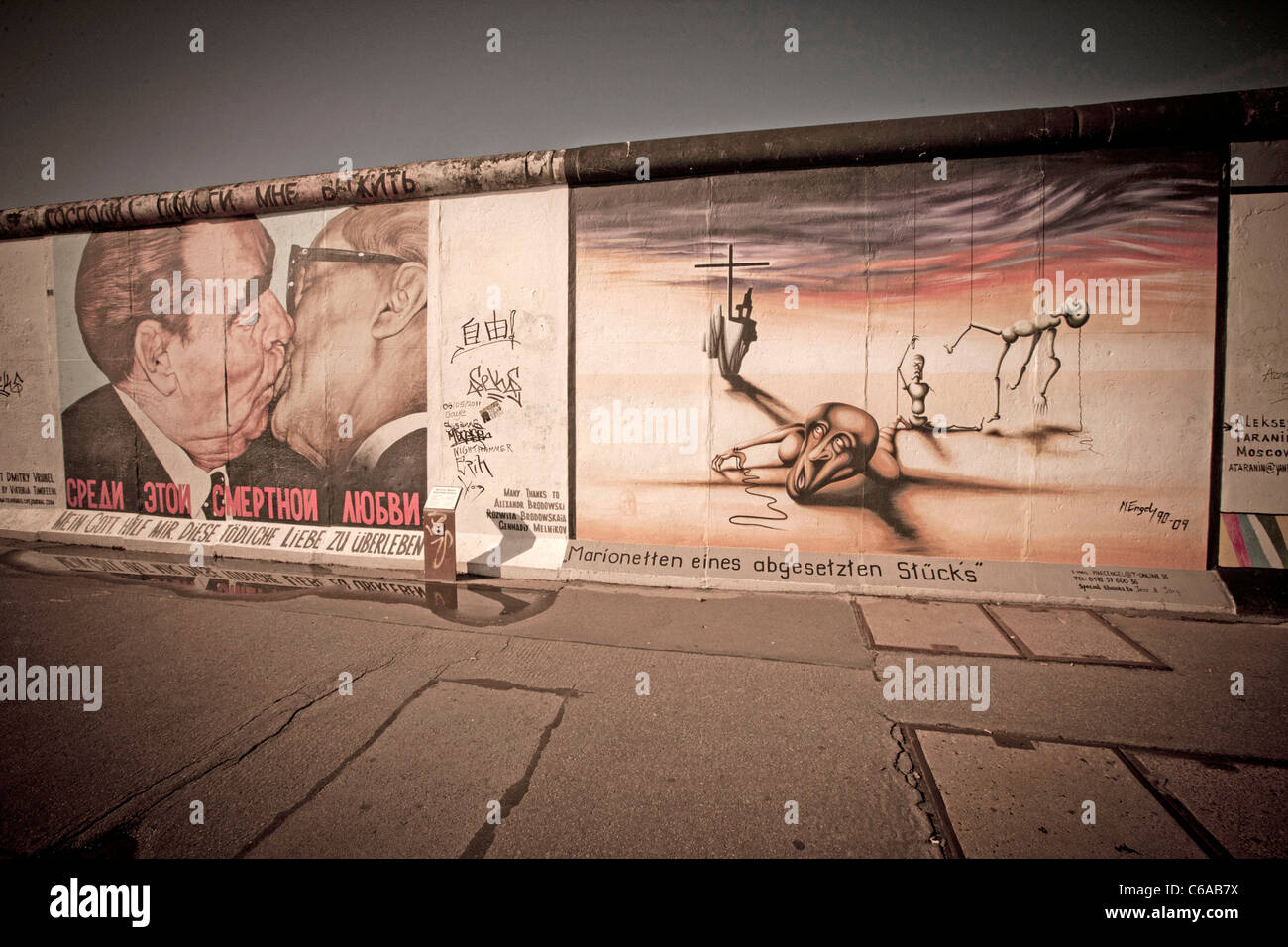 Repainted wall painting at East Side Gallery, Berlin Wall, Mauer, The kiss, Berlin, Germany - Stock Image