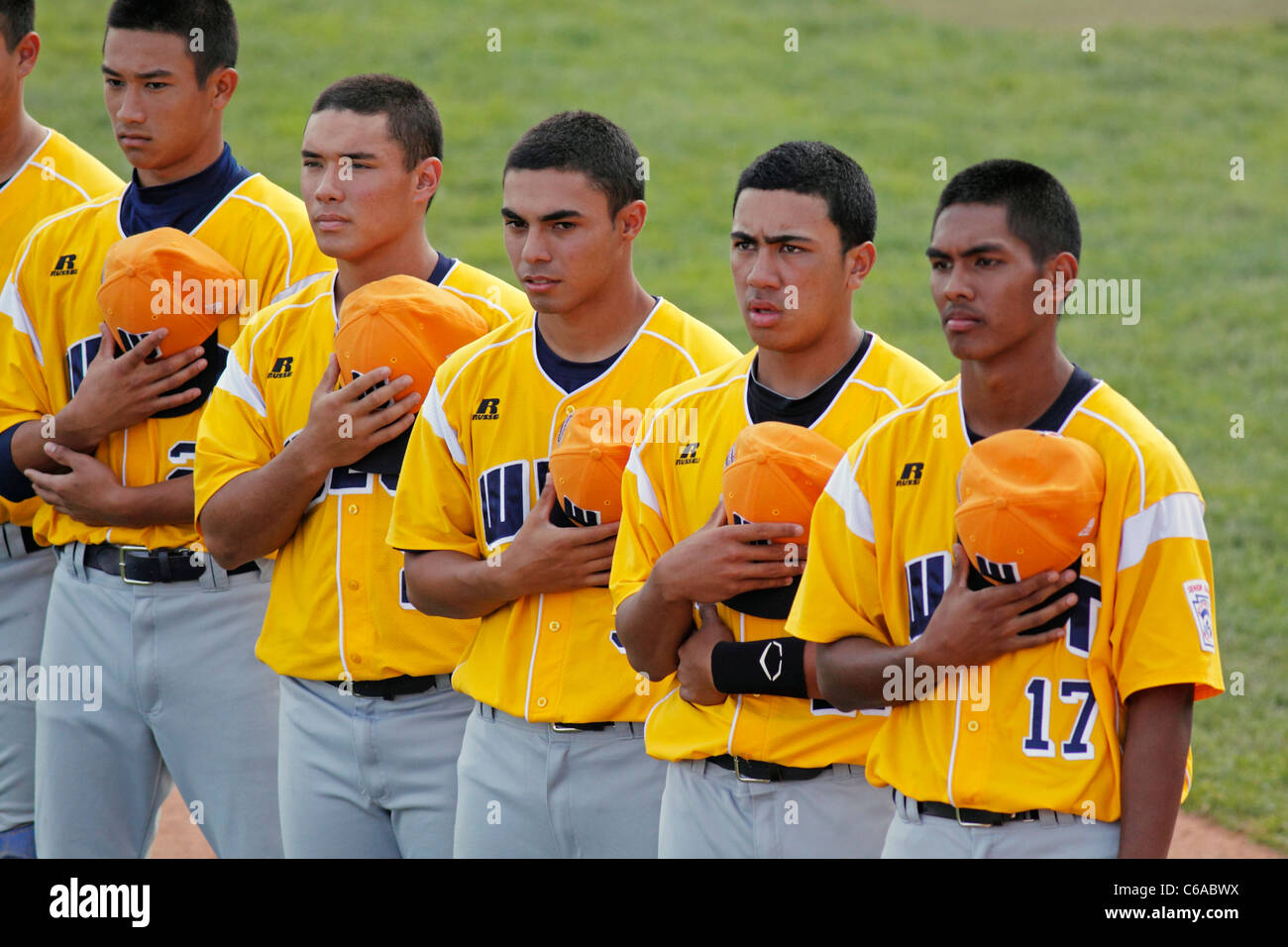 Players from US West (Hilo, Hawaii) during the national anthem at the 2011 Senior League Baseball World Series. - Stock Image
