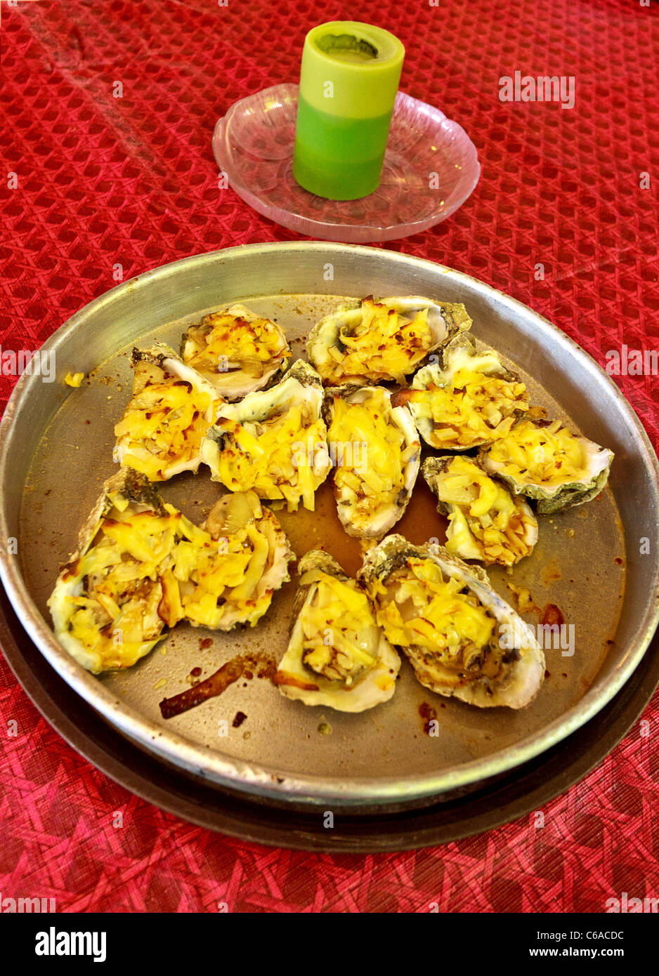 'Oysters Rockefella,' oysters served with spinach, onion, garlic and cheese at a restaurant in Apalachicola, - Stock Image