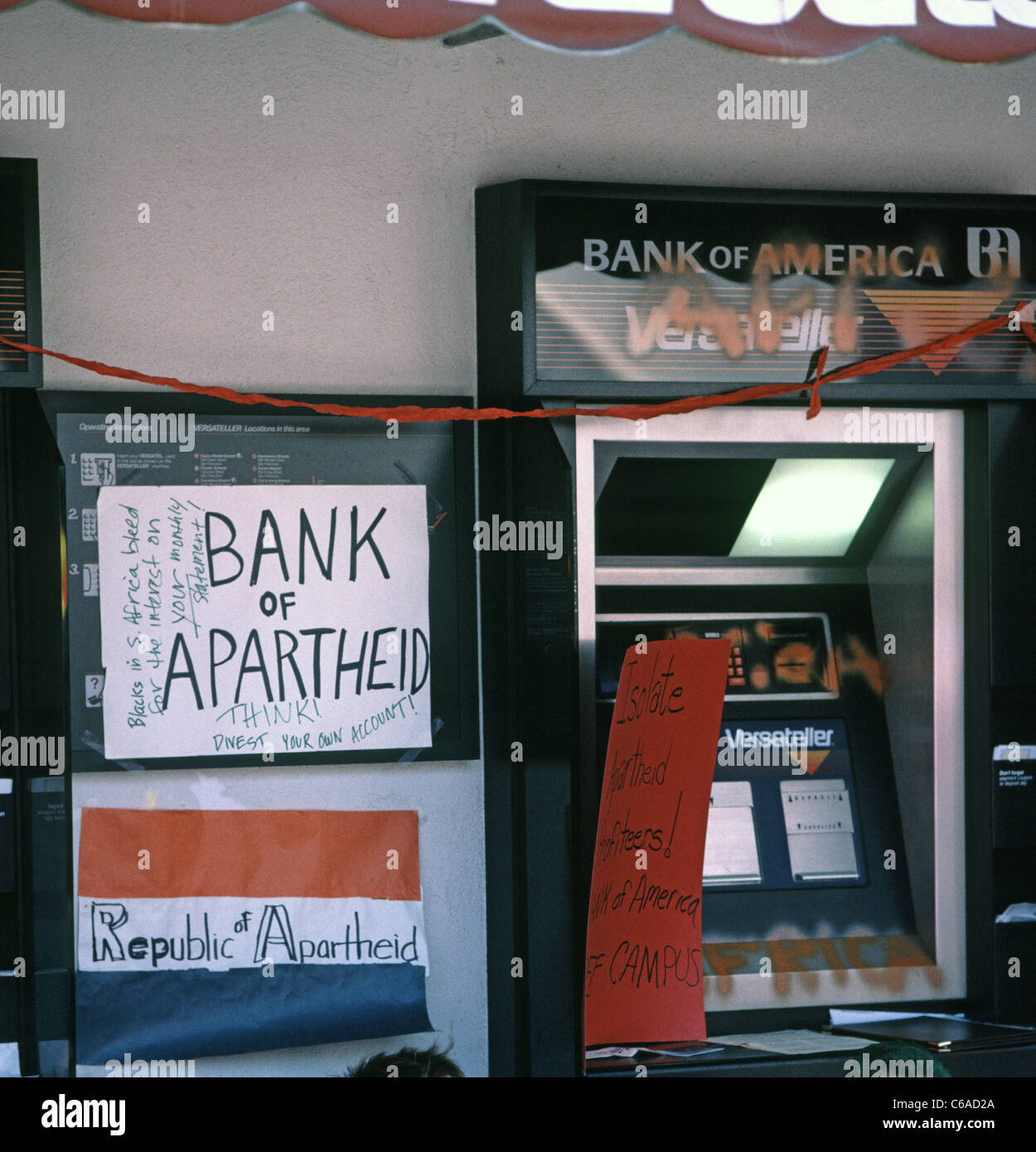 Anti South Africa Apartheid signs on a Bank of America versateller machine at San Francisco State University in - Stock Image