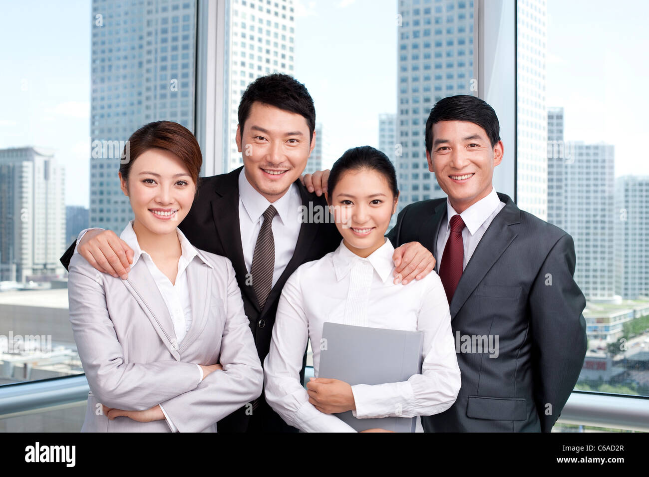 Portrait of businesspeople at the office - Stock Image