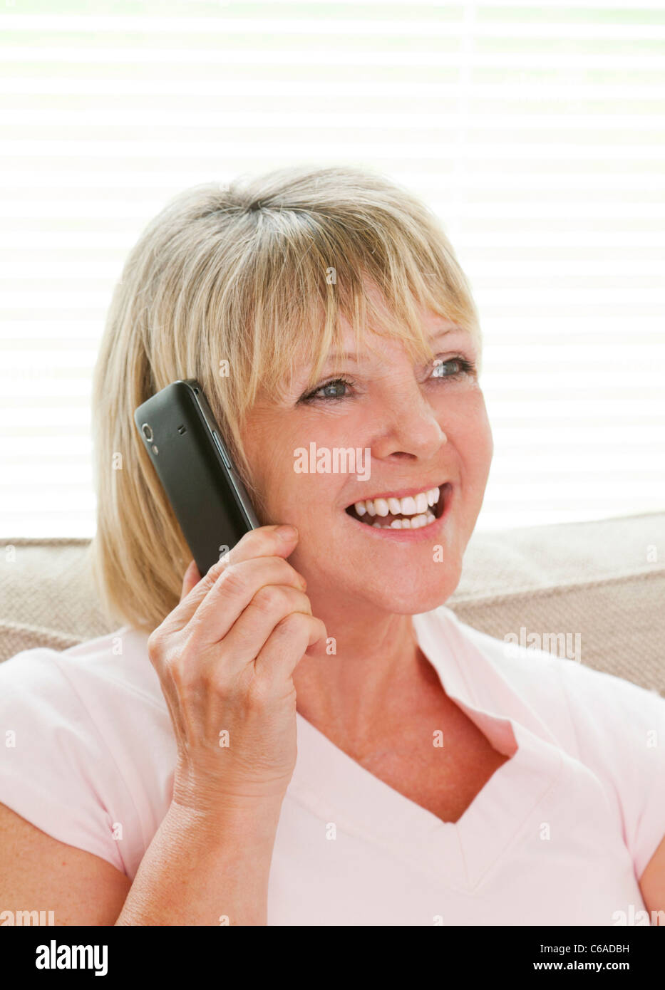smiling woman with mobile phone - Stock Image