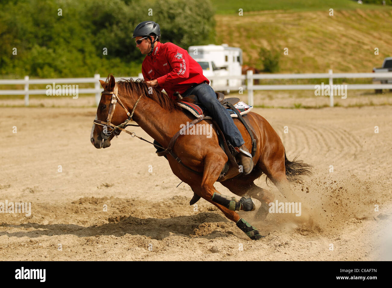 Chestnut sorrel horse and rider taking part in Western gaming race, Ontario, Canada - Stock Image